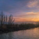 Foto van de zonsondergang bij de Carnisse Grienden